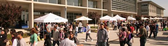 Students walk along Scholars Lane, a main walkway at UC Merced.