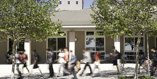 Students walk past the campus's dining commons at UC Merced.