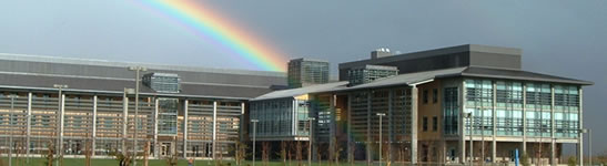 A rainbow appears behind the Science and Engineering Building.